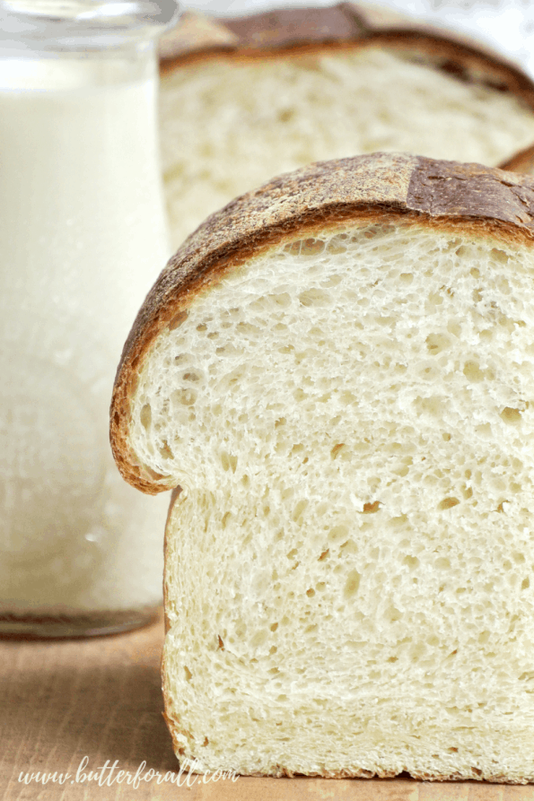 A close-up of a loaf of sliced sourdough milk bread.