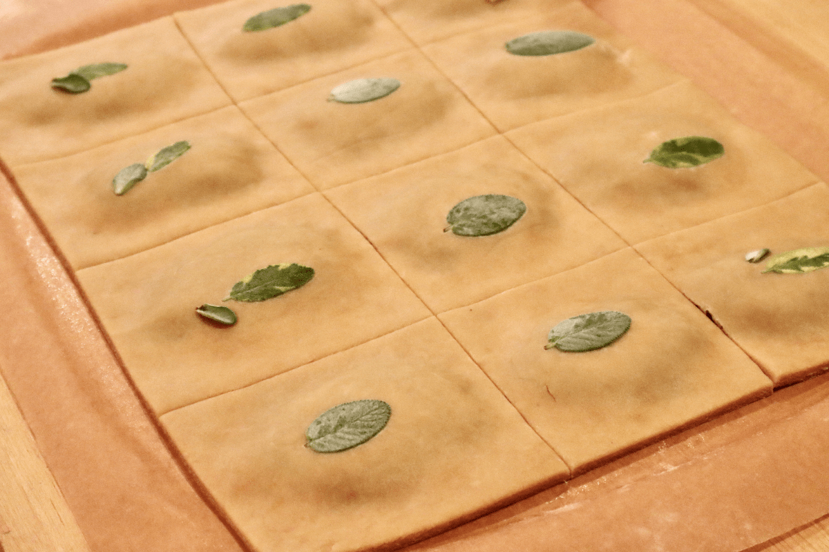 The dough is now cut in 12 even squares with the filling directly in the middle of each square.