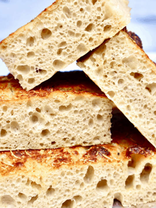 A stack of cut Focaccia show the open crumb structure.