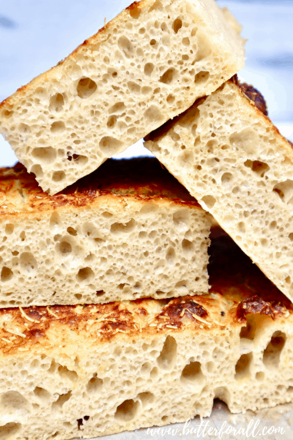 A stack of cut Focaccia showing the open crumb structure.