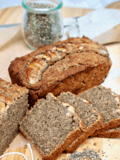 Freshly baked and sliced buckwheat banana bread with a jar of chia seeds.