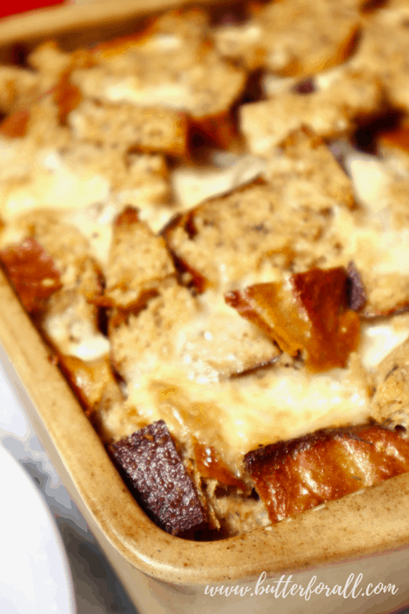 Golden brown melted cheese tops this savory bread pudding.