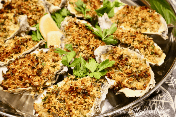 A pan of freshly baked sourdough-crusted oysters Rockefeller on the half shell.