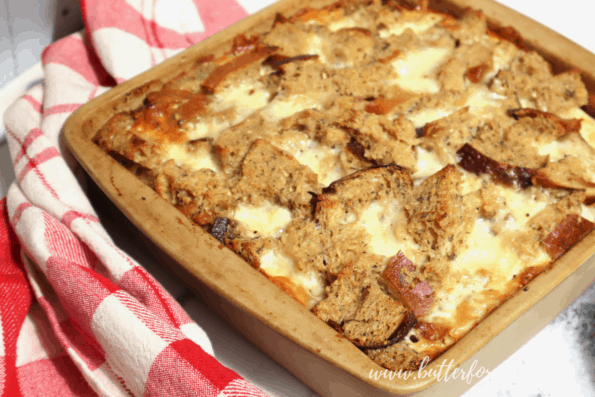 Cheesy bread pudding hot out of the oven.