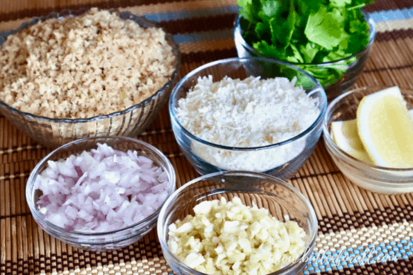 Bowls of sourdough breadcrumbs, Parmesan cheese, minced shallots, minced garlic, parsley, and lemon.